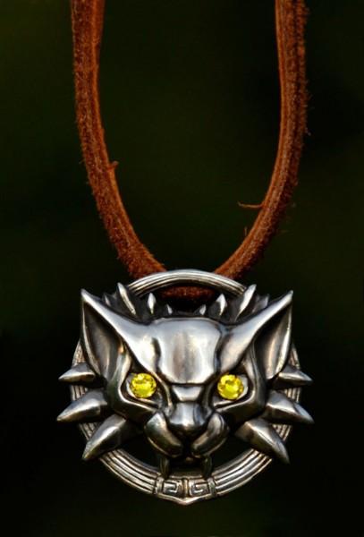 Медальон школы Кота